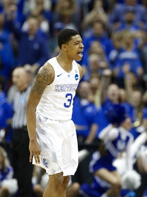 UK's Tyler Ulis pumping up the crowd. The Wildcats topped Cincinnati 64-51 to reach the Sweet 16.