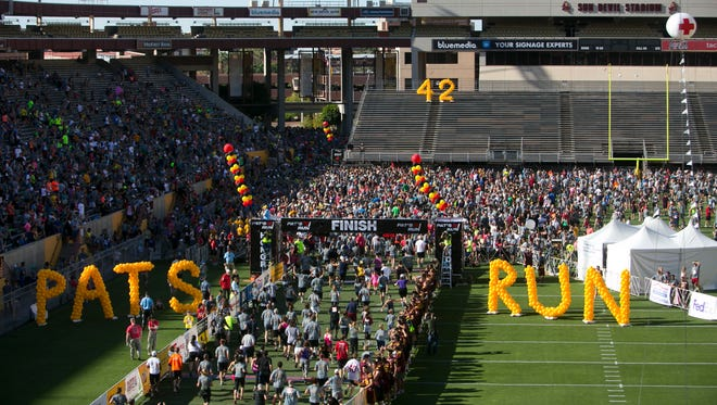 Thousands cross the finish line during the ninth annual Pat's Run in Tempe on Saturday, April 20, 2013.