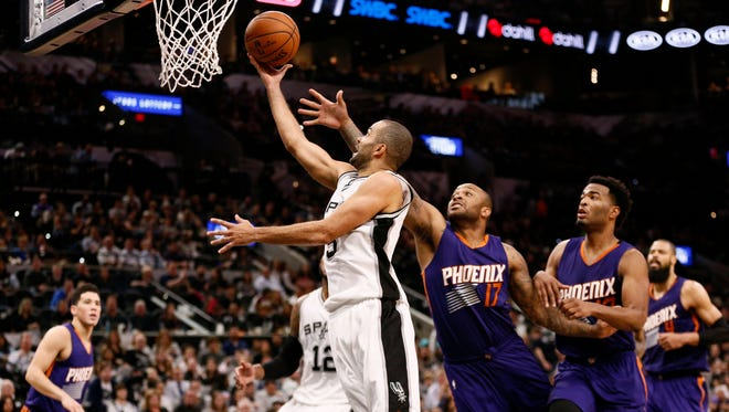 Dec 28, 2016; San Antonio, TX, USA; Spurs point guard Tony Parker (9) shoots the ball past Suns small forward P.J. Tucker (17) during the second half at AT&T Center.