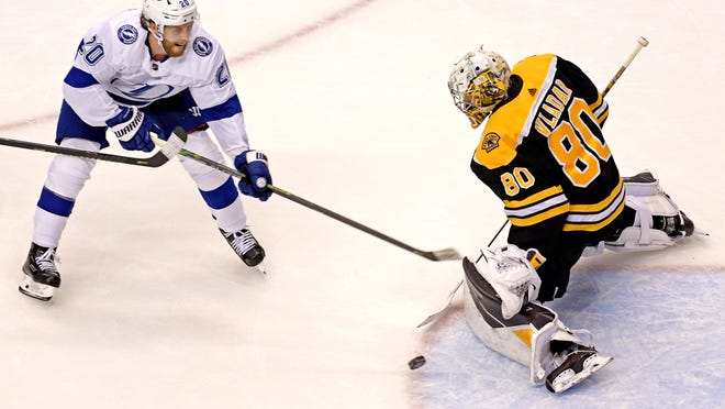 The Lightning's Blake Coleman directs a shot on Bruins goaltender Dan Vladar during Game 3 of the teams's second-round playoff series.