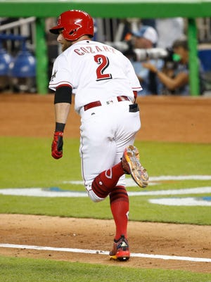 National League infielder Zack Cozart (2) of the Cincinnati Reds hits a single in the third inning during the 2017 MLB All-Star Game at Marlins Park.