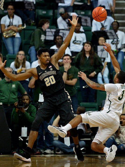 Wake Forest forward Terrence Thompson, left, applies defensive pressure on Charlotte guard Jon Davis, right, as Davis tries to shoot during the first half of an NCAA college basketball game in Charlotte, N.C., Tuesday, Dec. 5, 2017. (Jeff Siner/The Charlotte Observer via AP)