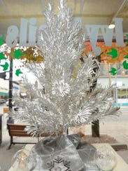 """One of many aluminum trees for the """"Evergleams"""" display"""