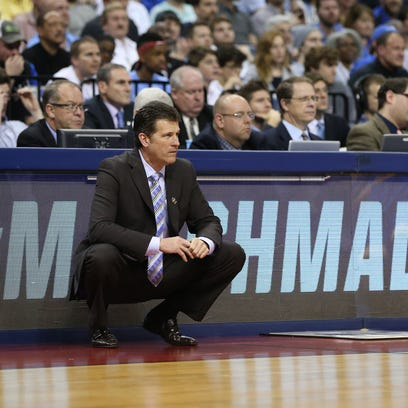 UCLA coach Steve Alford watches the action against