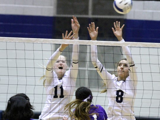 Piedra Vista's Stephanie Schmidt (11) and Bebe Jaquez (8) defend the net against Kirtland Central on Tuesday at the Jerry A. Conner Fieldhouse.