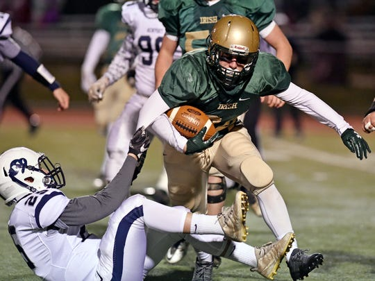 York Catholic's Andrew Snelbaker carries the ball against Newport in the second half of a PIAA District 3 Class 2A title game Saturday, Nov. 11, 2017, at Boiling Springs. York Catholic lost 26-7 to Newport in a rematch of last year's district championship game.