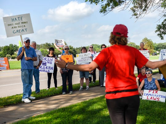 Demonstrators from Indivisible MN03 and Indivisible North Metro held signs in protest of the Immigration Customs Enforcement (ICE) detaining of immigrants Wednesday, June 27, outside the Sherburne County Government Center.