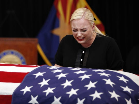 Meghan McCain, daughter of, Sen. John McCain, R-Ariz. cries at the casket of her father during a memorial service at the Arizona Capitol on Wednesday, Aug. 29, 2018, in Phoenix.