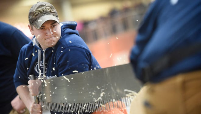 Chris Neufer, Bloomsburg, participates in a cross-cutting competition during the final day of the 2017 Farm Show in Harrisburg Saturday, Jan. 14. The event featured timbersport athletes from Penn State and professionals from the PA Pro Lumberjacks Association. The demonstration was sponsored by the Sustainable Forestry Initiative Implementation Committee.
