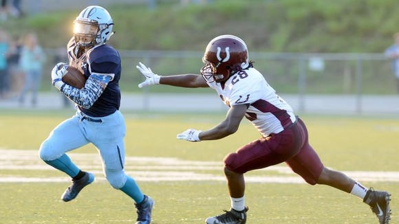 Enka's Michael Cantrell rushed for a career-high 308 yards Friday in Candler.