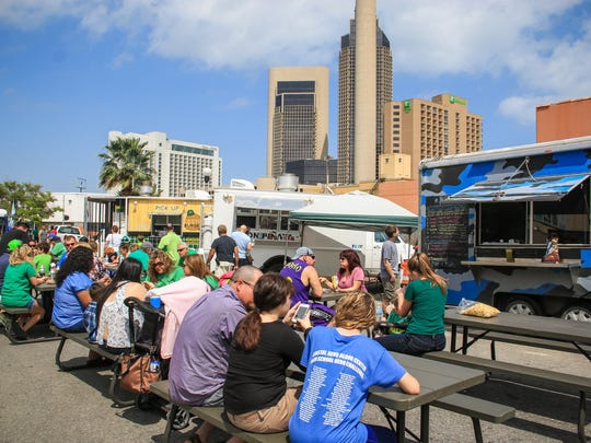 People gathered on North Chaparral street during the 2017 St. Paddy's festival to try the food trucks available.