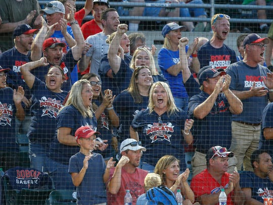 Marshalltown fans react to a Bobcats score against Urbandale in Class 4A action during the Iowa high school boys state baseball tournament on Wednesday, July 25, 2018, in Des Moines.