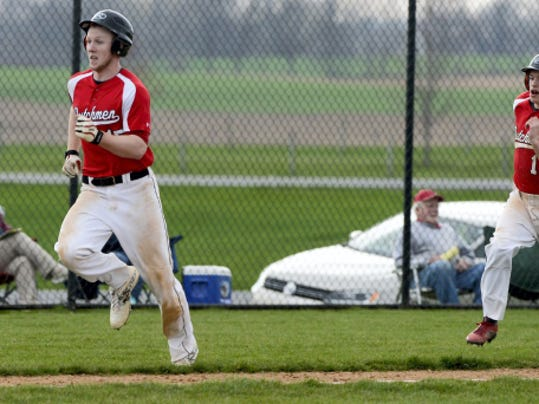 Annville-Cleona's Alec Barr (right) chases Noah Connor home during a Section Three-Four crossover game against Elco at Lyle Krall Field in Myerstown.