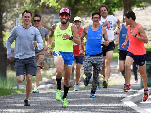 """Luis Contreras, middle in yellow, leads the """"Runny"""
