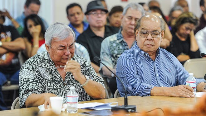 Leo Tudela, 73, pulls off his eyeglasses as he is overcome with emotions during his testimony in support of Bill 326 at the Guam Legislature in Hagatna on Monday, Aug. 1, 2016. Tudela testified that as a child, he served as an altar boy with the Mount Carmel Church in Chalan Kanoa, Saipan until he was given the opportunity to attend Catholic school on Guam. Tudela told lawmakers during his testimony that he was sexually abused by three members of Guam's Catholic Church, including a priest, on three different occasions.