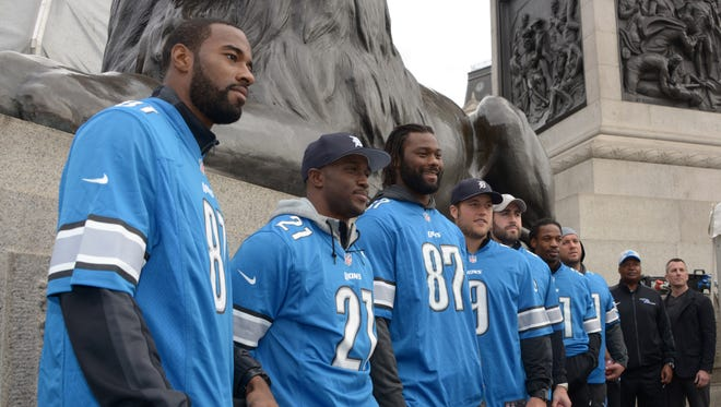 Oct 25, 2014: Detroit Lions receiver Calvin Johnson (81), running back Reggie Bush (21), tight end Brandon Pettigrew (87), quarterback Matthew Stafford (9), cornerback Rashean Matthis (31), long snapper Don Muhlbach (48), coach Jim Caldwell and president Tom Lewand at the NFL Fan Rally at Trafalgar Square in advance of the International Series game between the  Lions and the Atlanta Falcons.