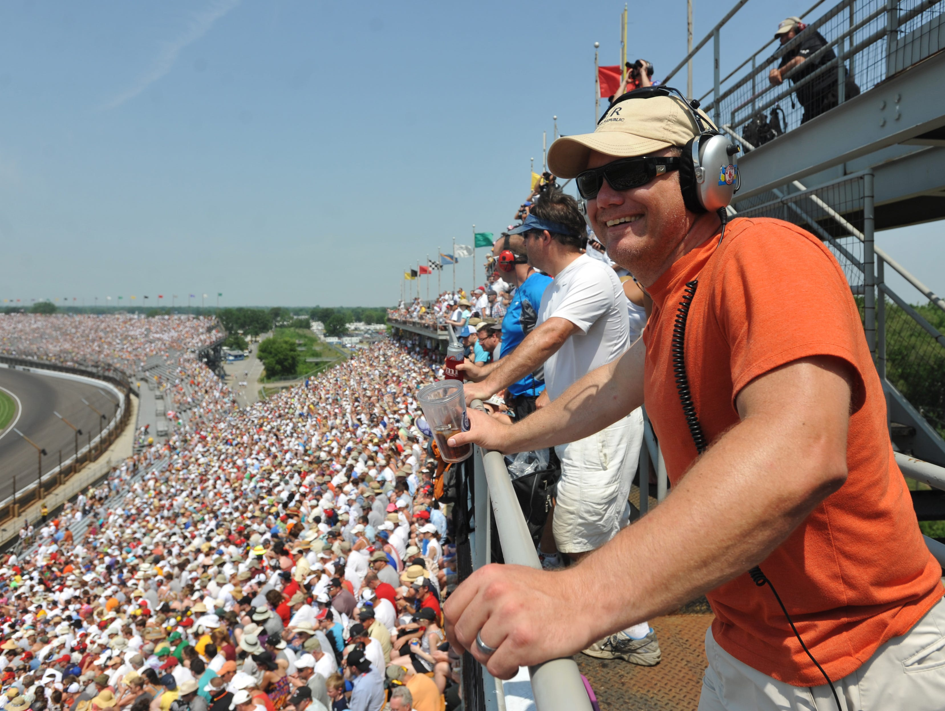 A fan enjoys the view from high up in Turn 3 during the 2012 Indianapolis 500.