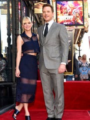 Actor Chris Pratt, right, poses with his wife, actress Anna Faris, during a ceremony to award Pratt a star on the Hollywood Walk of Fame on Friday, April 21, 2017, in Los Angeles.