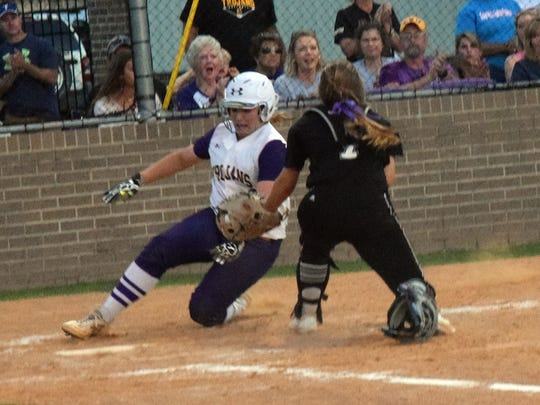 ASH's Bre Bennett (3, left) slides safely into home against Dutchtown in the Class 5A regional round.
