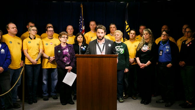 Travis Overley, a high school teacher from Bend, speaks at a press conference about the impact of cuts to the Public Employee Retirement System on Monday, Feb. 13, 2017, at the Oregon State Capitol. Two bills have been proposed for this legislative session, one that would change the calculation used to determine final average salary, and a second that would direct employee contributions away from individual account programs.