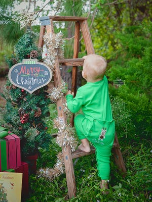 A photo from one of Trisha Harris' Christmas mini sessions. Many families hire a photographer each year for a photo to display on their Christmas card.