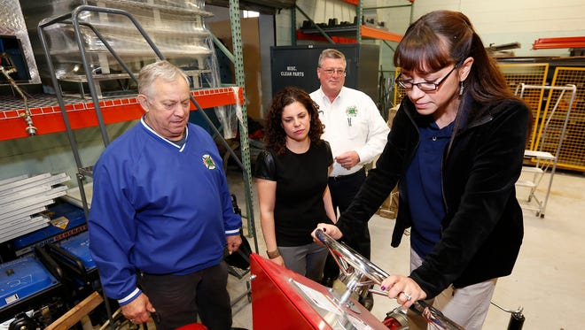 Rockland BOCES teachers Fanny Perez, front, and Marta Cortelli, center, get a hands on demonstration on a foam spraying device from Fire Training Instructors George Drescher, left, and Peter Byrne at The Rockland County Fire Training Center in Pomona on Tuesday, May 03, 2016.  Rockland BOCES will team up with the Rockland Fire Training Center to create a fire science curriculum for BOCES students.