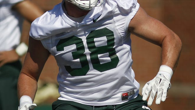 MSU junior LB Byron Bullough works on drills Monday, July 31, 2017, during MSU's first practice.