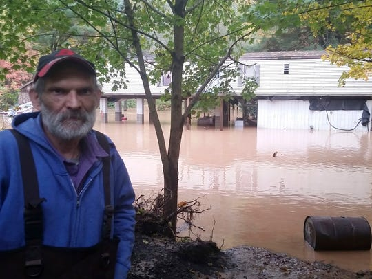 Sheb Brown, of Trout Run, Pa., stands behind his elevated