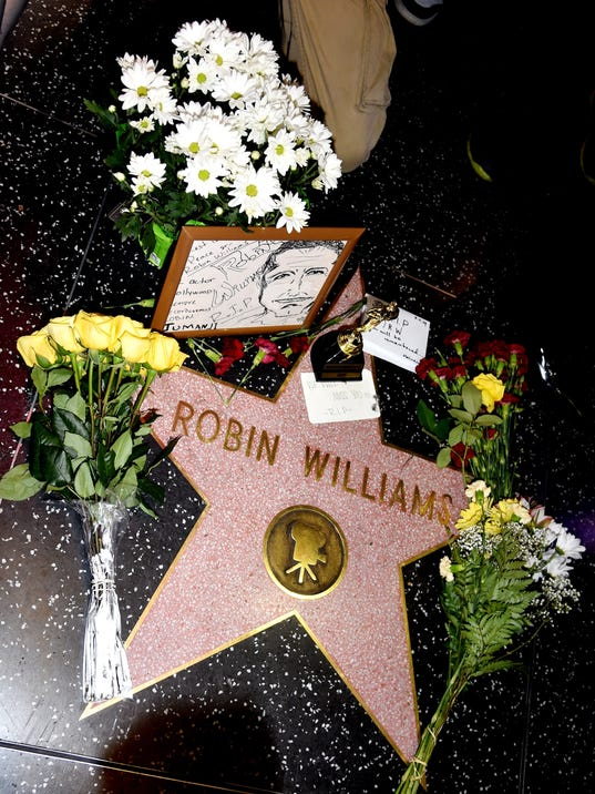 robin williams found hanged with a belt  cops say