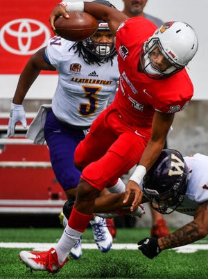 Defensive back Christian Uphoff of Washington runs the ball on a kickoff during a 2018 game with Western Illinois at Hancock Stadium.