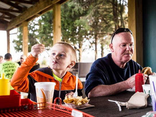 Mason Light, 5, enjoys milkshake from his straw while