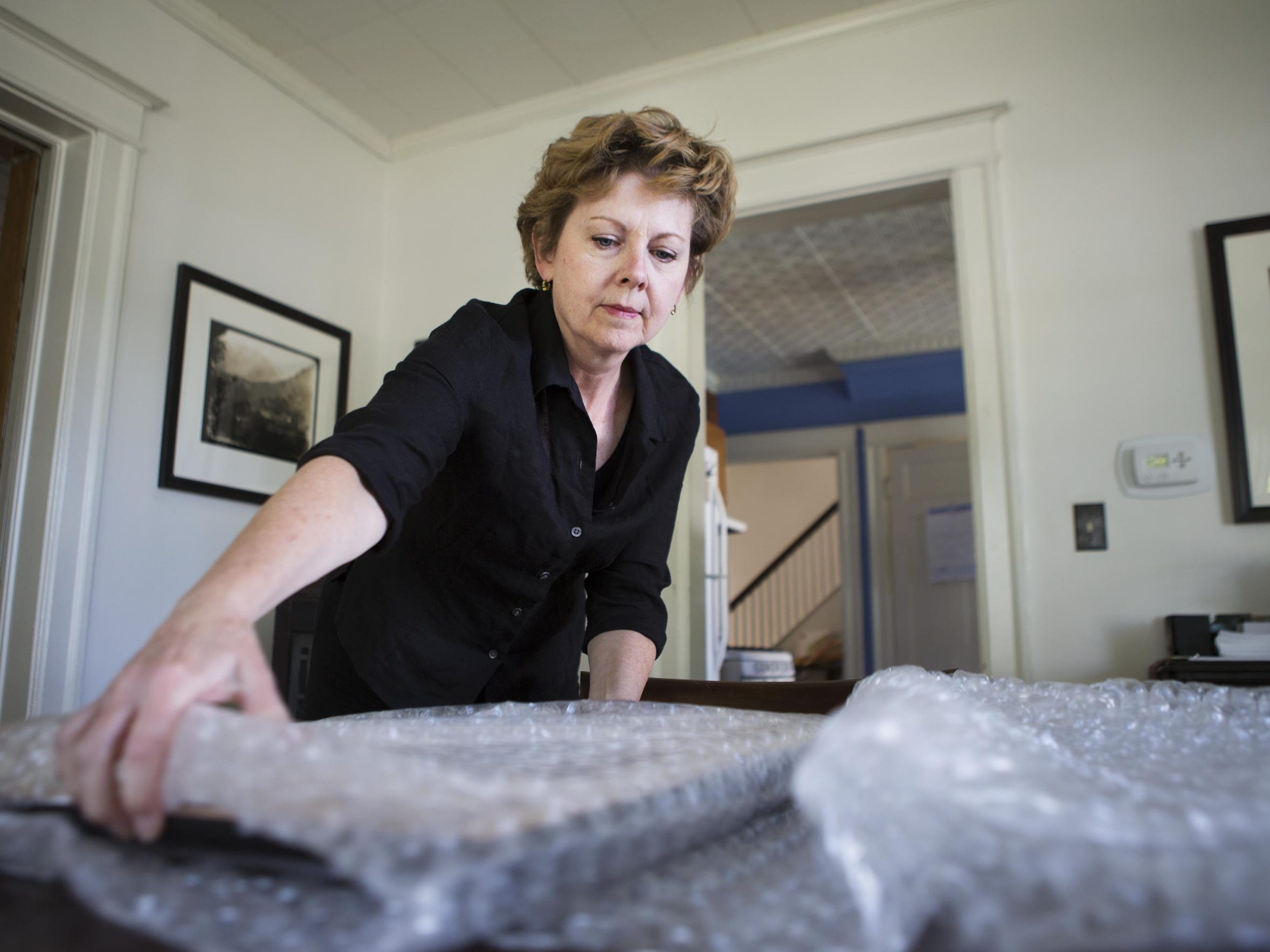 France Scully Osterman uses bubble wrap to pack a print
