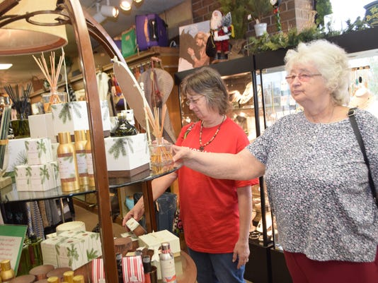 Jerry Rush (left) and Pat Taylor, both of Alexandria, look at items at John Ward Interiors on Small Business Saturday.