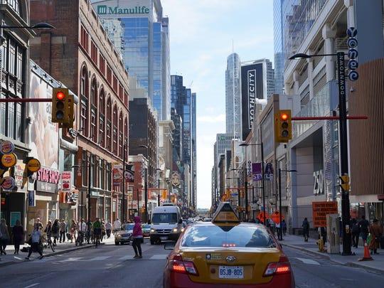 A bustling city street in Toronto, Ontario.