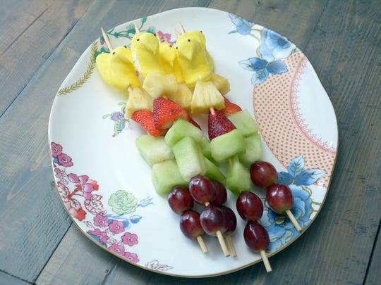 These fruit kebabs are topped with a Peep.