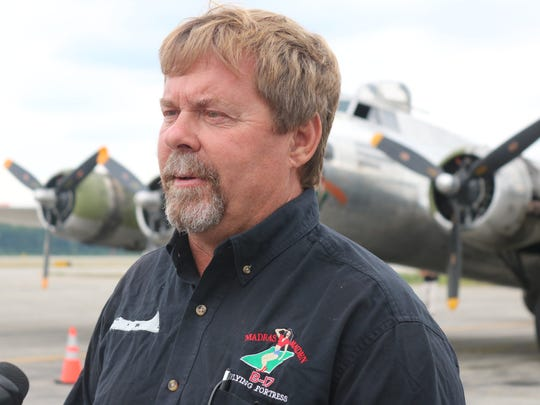 """Jon Eads, of the Liberty Foundation, works as a mechanic on the B-17 """"Madras Maiden,"""" flying with the historical plane all around the country."""