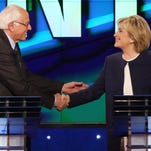 Hillary Clinton and Bernie Sanders (shake hands at the end of the Democratic presidential debate.