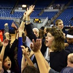 Nevada women's basketball head coach Jane Albright works with local children during the athletic department's annual All-Sports Clinic at Lawlor Events Center in Reno on Saturday. Albright recently won her 500th game.