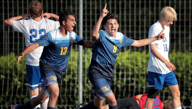 Lausanne's Vinny Garcia (8) celebrates with Kelvin Borges (13) after scoring in overtime against Battle Ground Academy to win the Division II-A championship Thursday.