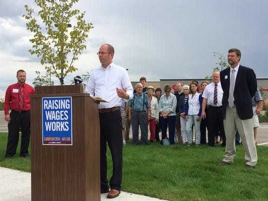 Rep. Eric Genrich, D-Green Bay, calls for increasing the minimum wage to $10.10 per hour during a Democratic campaign event by Costco in Bellevue Tuesday, Sept. 2. Genrich is seeking re-election to the 90th Assembly District.