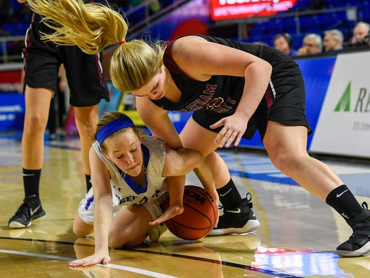 Macon County High School Jamie Ashburn (12)  struggles