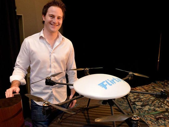 Matthew Sweeny,   chief executive officer of Flirtey, stands with one of his company's unmanned autonomous vehicles, or drones. The Australian company uses drones to deliver textbooks to customers and is partnering with the University of Nevada, Reno to develop a commercial delivery service.