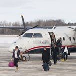 Passengers disembark from a US Airways Express flight in January 2014 at the Ithaca Tompkins Regional Airport.