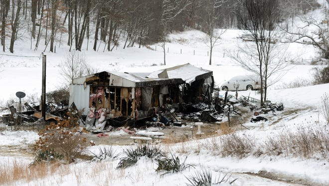 A gutted house trailer is all that's left at the scene of a fire that killed five people and injured two more. The early morning blaze was on Brushy Fork Road in Berne Township.