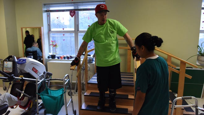 Stanley Auclaire practices walking up and down stairs at The Grand Rehabilitation and Nursing at River Valley in the City of Poughkeepsie.