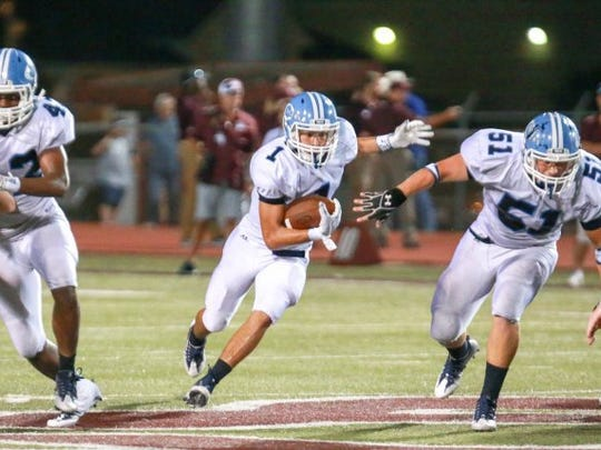 TRACY WEDDLE/SPECIAL TO THE CALLER TIMES Carroll's Patrick Medina (1) finds a hole on the right side of the line.