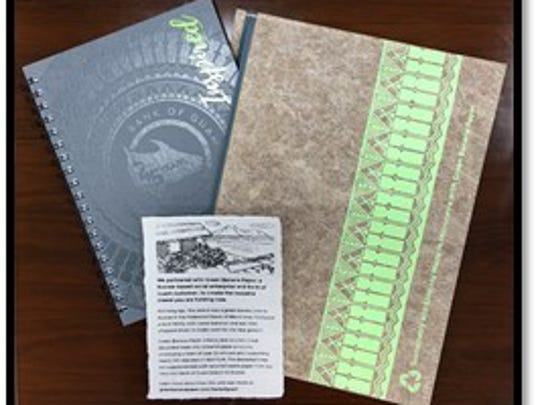 Green Banana Paper made reuseable, recycled banana paper sleeves as a wrap for the Bank of Guam's 45th anniversary notebook.