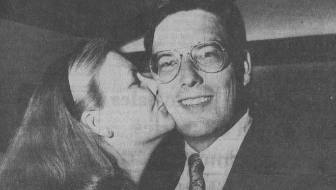 Buncombe County District Attorney Ron Moore gets a kiss from his wife, Beth Arrowood, the night of his Democratic primary victory in May 1990. Moore went on to win the general election in November, as well as five re-election campaigns, serving as District Attorney for 24 years.