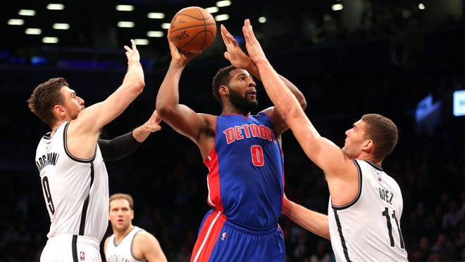 Feb 1, 2016; Brooklyn, NY, USA; Detroit Pistons center Andre Drummond (0) shoots the ball over Brooklyn Nets center Andrea Bargnani (9) and center Brook Lopez (11) during the first quarter at Barclays Center.