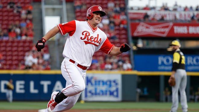 Cincinnati Reds' Scott Schebler runs to third on an RBI triple off Pittsburgh Pirates starting pitcher Ivan Nova during the second inning.